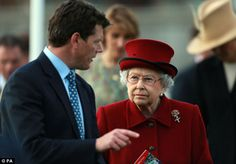Deep in conversation: The Queen chats with trainer Andrew Balding, brother of Clare, before the race 11th April 2014