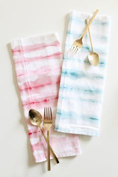 DIY WATERCOLOR STRIPED NAPKINS that are easy to make and fun to gift with a favorite cookbook or serving piece.