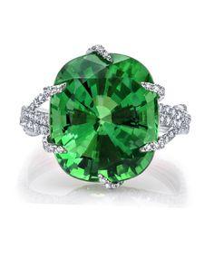 Martin Katz Ring Cushion-cut tsavorite garnet, 12.75 carats; microset with 275 diamonds and set in 18K white gold.