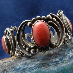 Bracelet    Los Castillo.  Silver Repousse  and coral.  ca. 1940s.