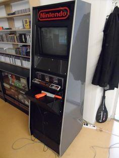 Nintendo NES M82 Demo Unit Cabinet in game room via NintendoAge user Gordijn