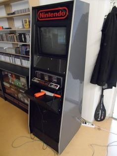 Nintendo NES M82 Demo Unit Cabinet in game room via NintendoAge user Gordijn
