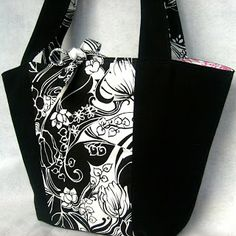 black and white eco tote with hot pink interior, made from reclaimed and recycled fabrics