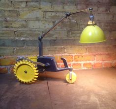 Repurposed vintage lawn tractor turned bedside reading light. Great for industrial themed boy's room.
