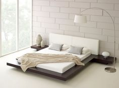 Bedroom. Fascinating Bedroom Scheme Featuring Scandinavian Wooden Bedstead With White Matress And Headboard Embellished With Sculpture Ornament Also Cool Arc Lamp Along With Brick Wall Surface Ideas. Graceful Scandinavian Design Bed For Our Homes