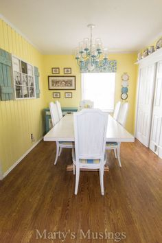 painted kitchen table - like the picture window frame on wall - use a wedding photo instead and place on my long dining room wall. Great idea, thanks!