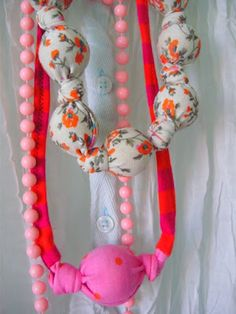 I'm not too crazy about the combination of fabrics, but this is an easy way to use up the clunky beads you may not like.