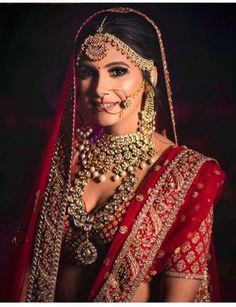 beautiful indian bride in a red wedding Lehenga and traditional polki bridal necklace jewellery. Best Bridal Makeup, Bridal Makeup Looks, Indian Bridal Makeup, Indian Bridal Outfits, Indian Bridal Fashion, Asian Bridal, Indian Wedding Jewelry, Bridal Looks, Bridal Style