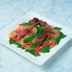 Use very fine rice noodles, sometimes called stir-fry rice noodles, for this recipe. They're ready after just four minutes in boiling water. We've added a spicy chilli soy sauce in a warm dressing to jazz them up, along with beef, peppers and mangetout.