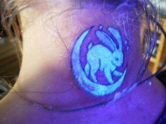 UV white Rabbit tattoo