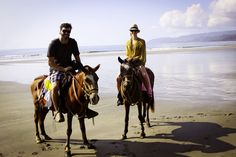 riding horses on the beach. want.