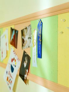 I saw rolls of corkboard at JoAnn Fabrics. I could buy that, molding and attach this to the kids walls by their homeschool desks.