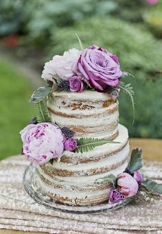 Love this! Naked Wedding Cake With Purple Flowers #Real Weddings, #Cakes, #Vintage, #Elegant, #Purple, #Color, #Naked Cake, #Peonies, #Unique Wedding Cake, #Wedding Cake Trends, #Glam, #Purple and Gold, #Styled Shoot, #Vintage Inspired #purpleweddingcakes #peonieswedding #weddingcakes #goldweddingcakes