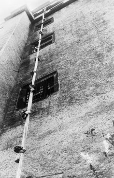 The rope of bed linen hanging on the west front of the guardhouse after the Polish Army officers, Lieutenant Mikołaj Surmanowicz and Second Lieutenant Mieczysław Chmiel, had been caught in mid-air, sliding past a window. Oflag IVC, Colditz Castle.