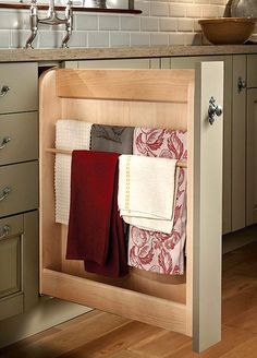 Wood-Mode Fine Custom Cabinetry offers a pull-out towel rack to keep towels within reach but out of sight.