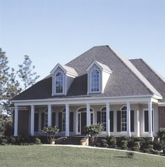 Lovely 4 - bedroom Southern Style home with front columned porch and large dormer windows.  Southern House Plan # 111026.