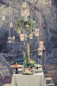 Outdoor Woodland Fairytale Wedding - hanging jars with candles inside looks so whimsical and pretty when it gets dark
