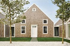 The Nantucket residence of entrepreneur Donald Burns was conceived by Jacobsen Architecture as a cluster of small structures.