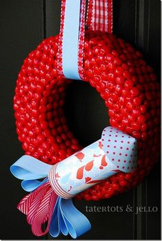 """Red Hots and Blue"" Fourth of July Rocket Wreath {tutorial} from Tatertots & Jello - It looks so cool and is made from candy!"