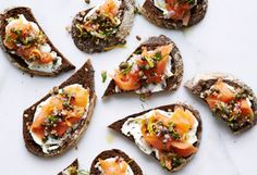 My smoked salmon tartines with red onion relish come together in no time: Spread pumpernickel toasts with herbed cream cheese, top with the salmon and a mixture of red onion, dill, and capers, and you're good to go.