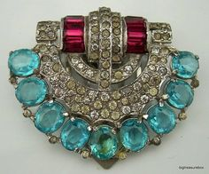 Deco Trifari dress clip. c. 1920s or 30s  this era created a pot metal that didn't stay beautiful over time. but oh the design was to die for (my personal opinion)