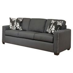 """Eco-friendly sofa with charcoal upholstery and nailhead accents. Made in the USA.   Product: SofaConstruction Material: Cotton, polyester and hardwoodColor: Charcoal and espressoFeatures:  Striking silver nailhead trimPlush pillow back cushions are detachableAccent pillows included Dimensions: 38"""" H x 88"""" W x 37"""" D"""