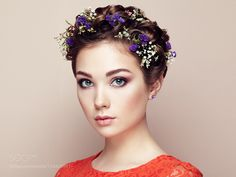 Face of beautiful woman decorated with flowers by heckmannoleg