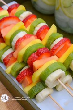 Party Fruit Kabobs - so easy! no recipe required! just slice bananas, kiwi, mangos and papaya and put them on skewers! Pretty & Healthy! Great picnic food or appetizers for a summer outdoor party.