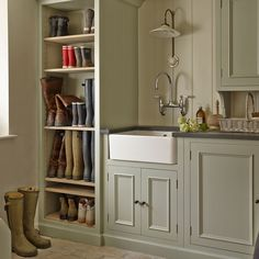 Traditional utility room with painted cupboards for boot storage Boot Room Utility, Utility Room Storage, Boot Storage, Utility Sink, Utility Room Sinks, Utility Cupboard, Shoe Cupboard, Utility Closet, Cupboard Storage