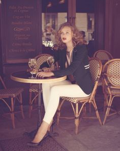 Love everything: from the jacket and the white pants, to the red lipstick.