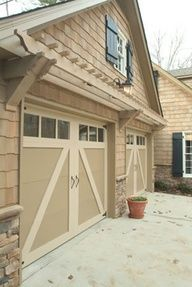 trellis above garage door: notice how the brackets are placed lower on either side of the garage doors.