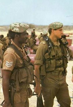"South African Defense Force 32 Battalion troopers in They both wear Pattern 83 ""battle jackets"", ""Transkei"" elite camo berets, and carry folding-stock Vektor automatic rifles. Military Life, Military Art, Military History, Military Uniforms, South African Air Force, Military Drawings, Defence Force, Military Equipment, African History"