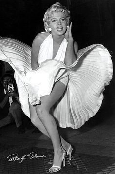 "This was a scene from the movie ""The Seven Year Itch"". The location shot in front of the Trans-Lux theatre in New York City had to be redone in the studio due to excessive crowd noise, but it yielded this picture. Date: 1954. Photographer: Matty Zimmerman"
