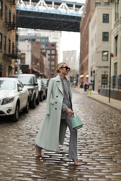 Mint wool overcoat over top of gingham matching pantsuit set.