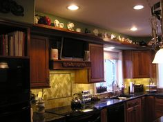 Kitchen Decor Above Cabinets what ideas do you have on what to put on top of kitchen cabinets