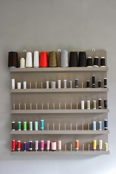 colorful thread storage on a neutral background. very elegant! Thread Storage, Sewing Room Storage, Sewing Room Decor, Sewing Room Organization, My Sewing Room, Sewing Rooms, Organization Ideas, Bobbin Storage, Coin Couture