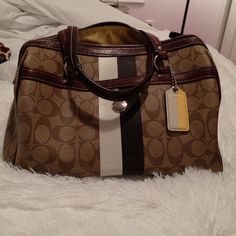 Coach Monogram Leather Bag Coach monogram print bag. Authentic leather. A few pen marks on the inside. Some wear on the bottom. No marks or stains on the outside. Yellow sheen inside lining. Brown print outside. Coach Bags Shoulder Bags