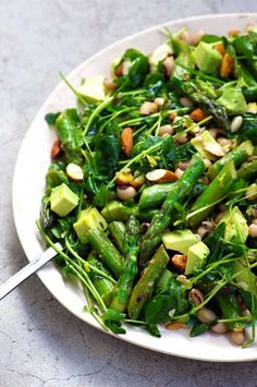 Asparagus Salad by Homespun Capers. Panfried asparagus with lemon and caraway, tossed with pea shoots, white beans and avocado. A seriously satisfying, yet light salad that is both zesty and creamy. There's nothing better than eating seasonally, and this is spring on a plate! Gluten free, vegan, grain free.