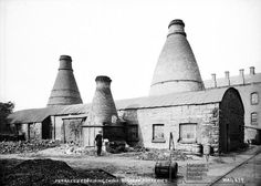 Furnaces for firing China with a worker in the foreground, Belleek Potteries