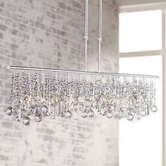 """Luminous Collection 48"""" Wide Crystal Chandelier"""