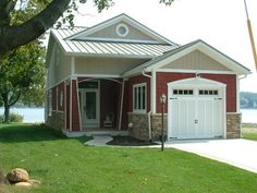 """Certainteed. 7"""" vinyl shake """"Autumn Red"""" and the triple 2"""" vertical siding is """"Desert Tan."""""""