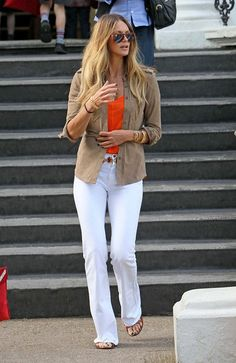 Chic White BootCut Jeans, Tan Button Down, Orange Tee, and Sandals with great jewelry pieces.