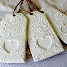 Paisley heart embossed clay gift tags, like the  heart in relief in lace setting as a cupcake topper idea