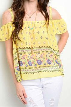 Adorable summer print top. Light-weight fabric off-the-shoulder style with lace straps. Looks great with shorts or jeans.  Cold Shoulder Top by Golden Terri. Clothing - Tops - Short Sleeve Houston Texas