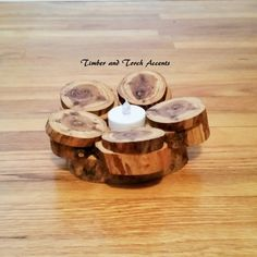 Wood tea light holder.  Add a woodsy feel to your rustic wedding table or home décor with this tree slice tea light holder.  Approximate