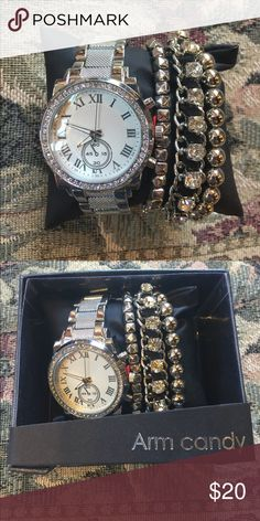 NWT Arm Candy Crystal Rhodium watch set. #I NWT Arm Candy Rhodium Mesh band watch and crystal silver bracelet set. Box included. Fun cute trendy affordable jewelry to coordinate your style and outfits. Buy 1 @ $20 or get a second set of your choice for $30. All orders are shipped same or next business day. Bundle to save even more money! Arm Candy Accessories Watches