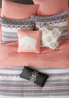Update your bedroom decor with this comforter set. A black and white tribal print is accented with light coral to create a unique look. It's a boho chic design that elevates your bedroom.