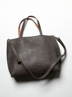 Free People Slouchy Vegan Tote, $68.00  This reversible, carry-everything vegan leather tote features an elegant shape and large removable zipper pouch, perfect for storing a laptop, tablet, or other odds and ends. Attached small zipper pouch makes an ideal coin purse! Removable and adjustable long leather strap. Magnetic snap closure. *100% Vegan Leather