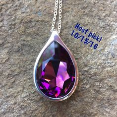 Handcrafted necklace made with Swarovski crystal This necklace is made with a genuine sparkly amethyst colored (dark purple) Swarovski crystal in a beautiful pear shaped gold-toned pendant. This is so eye-catching. 2nd picture for approximate sizing.  Hubby & I make our jewelry using genuine Swarovski crystals.  All items are brand-new and much prettier in person than pictures.  Proceeds used to help our 5-yr-old granddaughter Lila May in her fight against cancer, but she lost her battle…