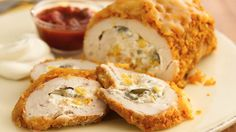 Flattened chicken breasts with a crunchy coating hold a delicious cheesy filling.